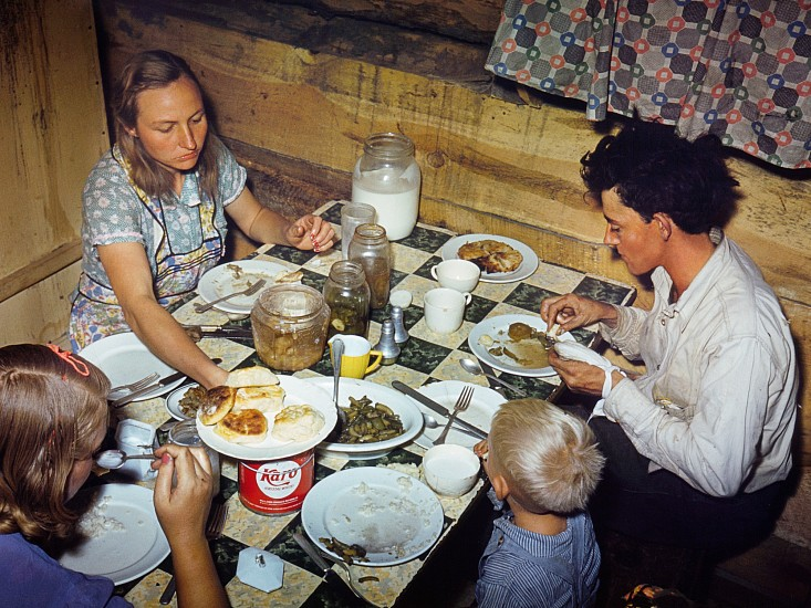 Debbie Grossman, The Fae and Doris Caudill family eating dinner in their dugout 2009-10, Pigment print